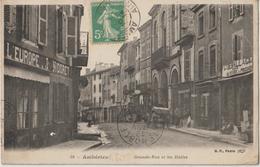 AMBERIEU - Grande Rue Et Les Halles - A Droite Grand Déballage Au Bazar Du Travail Des Prisons - Autres Commerces. - Francia