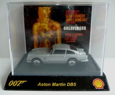 ASTON MARTIN DB5   JAMES BOND 007 GOLDFINGER  -  Marque TIC TOC - Collectors Et Insolites - Toutes Marques