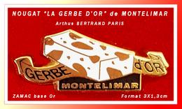 """SUPER PIN'S NOUGAT-Arthus BERTRAND : Morceau De NOUGAT De MONTELIMAR, Marque """"LA GERBE D'Or"""" En ZAMAC Base Or, 3X1,3cm - Arthus Bertrand"""
