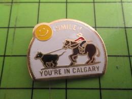 812b Pins Pin's / Rare & De Belle Qualité  THEME : VILLES / VACHE VEAU RODEO CANADA SMILE YOU'RE IN CALGARY - Villes