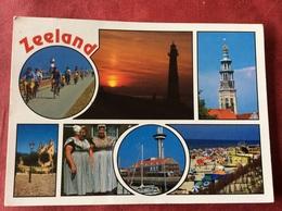 Nederland. Pays-Bas. Holland. Zeeland ( Klederdracht Boot Vuurtoren Fietsers ) - Netherlands
