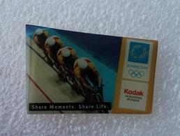 Pin's Jeux Olympiques Athens 2004 . Cyclisme . Sponsor Kodak - Olympic Games