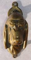 Petit Heurtoir En Bronze Tête De Chien -  Poids 71 Grs. Long. 8,4 Cm - Bon état. - Bronzes