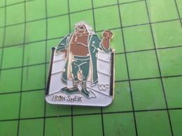 SP17 Pin's Pins /  Rare & De Belle Qualité : THEME SPORTS / LUTTE CATCH CATCHEUR IRON SHEIK - Lotta