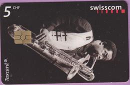 Télécarte Suisse °° SE.101A. Jazz Saxo - 5CHF - Gem7 - 06.2001 - R. - Suisse