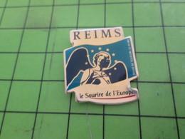 313k Pins Pin's / Rare & Belle Qualité THEME : VILLES / REIMS LE SOURIRE DE L'EUROPE ANGE ARCHANGE - Städte