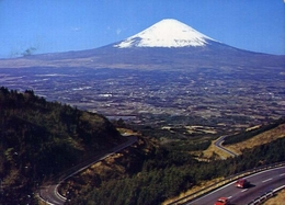 Mt.fuji - The Holy Peck Of Japan Reveals Its Perfect Cone Against Blue Sky - In The Foreground Is Gotenba City - Formato - Cartoline