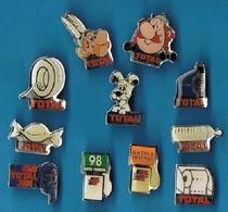 11 PIN'S //  ** CARBURANT ET DÉRIVÉS TOTAL // OBELIX / ASTERIX / IDEFIX / PARIS LE CAP, Etc... ** - Pin's