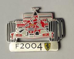 L270 Pin's Ferrari Officiel F2004 SUPERBE Qualité Egf Signé Bolaffi 32 Mm X 22 Mm RARE Achat Immediat - Ferrari