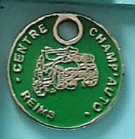 Jeton De Caddie Argenté  Ville  Automobile  Centre  CHAMP ' AUTO à REIMS  Verso  IMPORTATIONS TOUTES MARQUES ( 51 ) - Trolley Token/Shopping Trolley Chip