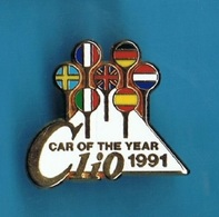 1 PIN'S //  ** RENAULT CLIO / VOITURE DE L'ANNEE / 1991 ** . (Arthus Bertrand Paris) - Arthus Bertrand