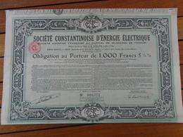 NOUVEAU - ALGERIE - STE CONSTANTINOISE D'ENERGIE ELECTRIQUE - OBLIGATION 1000 FRS  1/2% - BONE 1932 - Shareholdings