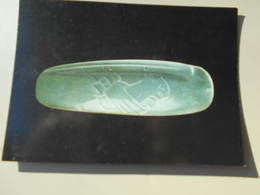 COSTA RICA NATIONAL MUSEUM OF COSTA RICA STYLISED JADE SEASHELL WITH HALF FELINE HALF INSECT HELD BY HUMAN HAND TIBAS - Costa Rica
