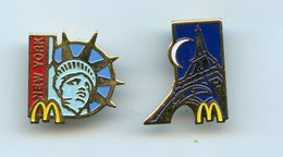 PINS - PIN'S -LOT 2 PIN'S SIGNÉS ARTHUS BERTRAND -MAC DONALD'S  -  PARIS TOUR EIFFEL Et NEW-YORK  STATUE DE LA LIBERTE - McDonald's