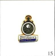 Pin's - Entreprise - Montre Chrono Pour Performance Européenne (Travail Temporaire). Est. A.B. Zamac. T323-15 - Badges