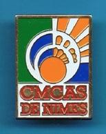 PIN'S //  ** C.M.C.A.S / DE NIMES ** - EDF GDF