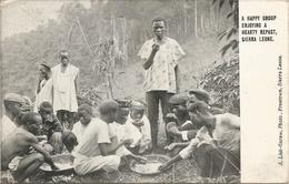 A HAPPY GROUP NJOYING A HEARTY REPAST, SIERRA LEONE.  (scan Verso). - Sierra Leone