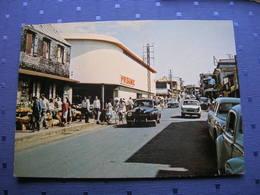 Cpsm 10x15 NV St Saint Denis De La Reunion Prisunic Rue Marechal Leclerc Voiture Ancienne Velo Superbe Bon Etat - Saint Denis