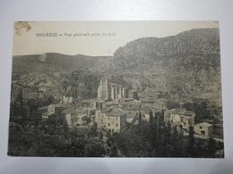 34 Mourèze, Entrée Du Village Prise Du Sud. Carte Inédite (7904) - France