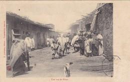 AFRIQUE. MADAGASCAR. CPA. ANIMATION. UNE RUE DE HARAR.. ANNEE 1909 - Madagascar