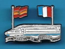 PIN'S // ** EXPO 92 / SÉVILLE / TRAIN / AVE / ALTA VELOCIDAD ESPAÑOLA // FRANCE / ESPAGNE **. (© Qualité Collectors) - TGV