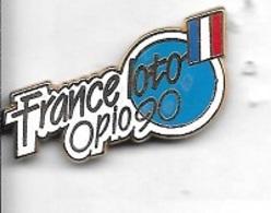 Pin's  ARTHUS  BERTRAND, Jeux  France  Loto  Opio  90  Avec  Drapeau  Tricolore - Jeux