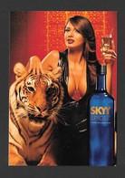 PUBLICITÉ - ADVERTISING - SKYY VODKA - SKYY SPICED & COKE - JOLIE FILLE AVEC LION - PHOTO MATTHEW ROLSTON - Publicité