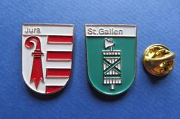2 Pin's, Ville,Village,JURA, ST.GALLEN,blason, Suisse, Wappen, - Villes