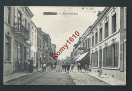 Quiévrain. La Grand'Rue. Commerces, Animation...Circulé En 1918. Feldpost.   2 Scans. - Quiévrain