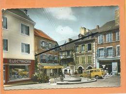 CPSM Grand Format - Ussel -( Corrèze ) - Boulevard Foch Et Rue Michelet (auto , Voiture Ancienne Peugeot 403 ) - Ussel