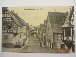 Cpa OBERBRONN (67)  Une Rue Du Village - France