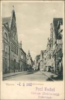 Ansichtskarte Güstrow Mühlenstraße, Geschäfte 1902 - Güstrow