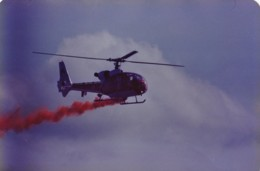 AL98 Aviation Photograph - Display Helicopter With Red Smoke - Aviation