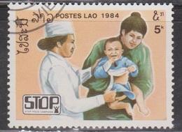 LAOS Scott # 599 Used - Nurse, Mother & Child - Laos