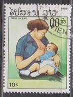 LAOS Scott # 672 Used - Mother Breastfeeding Child - Laos