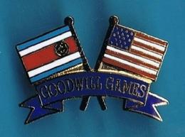 1 PIN'S  //  ** GOODWILL GAMES / CORÉE DU NORD & USA ** . (© & TM SOC) - Badges