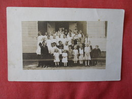 RPPC   Group Photo With Boy On Crutches     Ref 3177 - To Identify