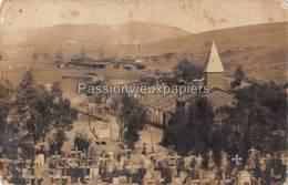 CARTE PHOTO ALLEMANDE  CREPION   1917   EGLISE CIMETIERE LAGER ? CAMP ? - France