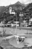 R172643 Fluelen Am Vierwaldstattersee Mit Rophaien. Photoglob Wehrli - Ansichtskarten