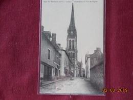 CPA - Le Pertre - La Rue De Brielles Et La Tour De L'Eglise - France