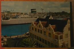 CPM Curaçao, Netherlands Antilles : Grace Line 'Santa' Cruiser Passing Through Narrow Entrance Of Willemstad's Harbour. - Postcards