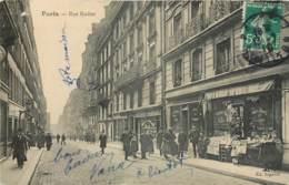 PARIS RUE RODIER ANIMEE DEVANTURE LIBRAIRE LIVRES NEUFS OCCASIONS LIBRAIRIE PRESSE 75009 - District 09