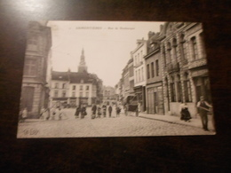 CPA ANIMEE - ARMENTIERES - RUE DE DUNKERQUE - COMMERCES - Marchands