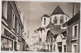 Saint Satur  (18) - CPSM -  L'église ... Nouveautes Confection - Garage Citroen - Saint-Satur