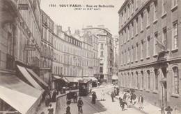 75 PARIS. CPA  ANIMATION ET COMMERCES RUE DE BELLEVILLE . TRAMWAY - Paris (20)
