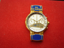 MONTRE C.E ALSTHOM BLEUE Pin's ARTHUS BERTRAND - Arthus Bertrand