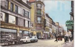 Bt - Cpsm Petit Format ST DENIS - Rue Gabriel Péri (commerces : Tabac, Ets Ronat, Comptoir Des 4 Rues & Voitures ) - Saint Denis
