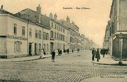 LUNEVILLE - Rue D'Alsace Le Restaurant H Simonin Et En Face Magasin De Confection - Luneville