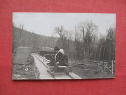 RPPC Man On Rail Cart        Ref 3230 - To Identify