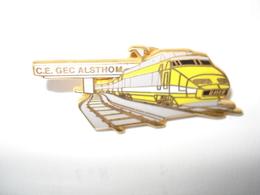 TGV JAUNE ALSTHOM Pin's Signé ARTHUS BERTRAND - Arthus Bertrand